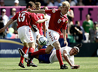 ◊Copyright:<br />GEPA pictures<br />◊Photographer:<br />Dominic Ebenbichler<br />◊Name:<br />Camoranesi<br />◊Rubric:<br />Sport<br />◊Type:<br />Fussball<br />◊Event:<br />Euro 2004, Europameisterschaft, EM, Italien vs Daenemark, ITA vs DEN<br />◊Site:<br />Guimaraes, Portugal<br />◊Date:<br />13/06/04<br />◊Description:<br />Peter Skov-Jensen (DEN), Maro Camoranesi (ITA), Christian Poulsen (DEN)<br />◊Archive:<br />DCSDE-130604710<br />◊RegDate:<br />14.06.2004<br />◊Note:<br />9 MB - KA/KA - Gemaess UEFA keine Nutzungsrechte fuer Mobiltelefone, PDAs und MMS-Dienste - no MOBILE - no PDAs - no MMS