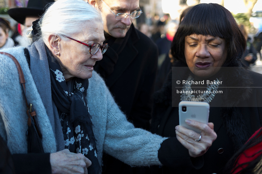 Veteran actor and political activist, Vanessa Redgrave CBE (left), shows phone footage to Labour MP, Diane Abbott, at a protest for the child refugee charity, Safe Passage, in Parliament Square Westminster, on 20th January 2020, in London, England.