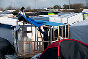 France , Calais, camp for refugees known as 'The Jungle'. November 2015. Refugees build a new shelter.