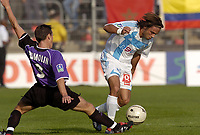 Fotball<br /> Frankrike 2004/05<br /> Istres v Olympique Marseille<br /> 2. oktober 2004<br /> Foto: Digitalsport<br /> NORWAY ONLY<br /> FABRICE FIORESE (OM) / CHRISTOPHE DUMOLIN (IST)