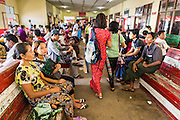 """17 JUNE 2013 - YANGON, MYANMAR:  The waiting room on the Yangon side of the Yangon-Dala Ferry. The ferry to Dala opposite Yangon on the Yangon River is the main form of transportation across the river. Every day the ferry moves tens of thousands of people across the river. Many working class Burmese live in Dala and work in Yangon. The ferry is also popular with tourists who want to experience the """"real"""" Myanmar. The rides takes about 15 minutes. Burmese pay about the equivalent of .06¢ US for a ticket.  Foreigners pay about the equivalent of about $4.50 US for the same ticket.   PHOTO BY JACK KURTZ"""