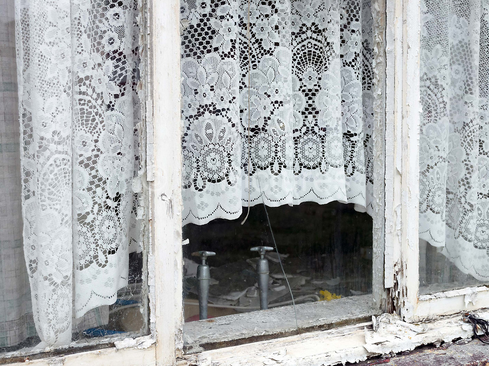 Window of an abandoned house on the island of Scalpay on the Isle of Harris, Outer Hebrides, Scotland on 20 July 2018
