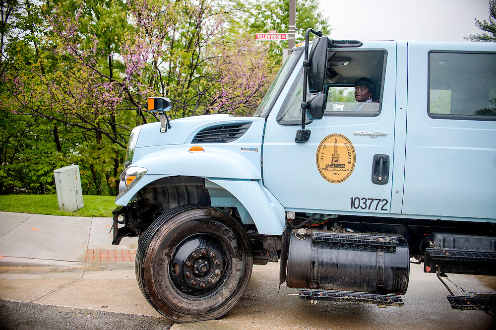 Photo by Matt Roth<br /> <br /> Cecilia Cozart, a motor vehicle driver I with the Baltimore City Department of Public Works, carts off cement debris in her truck at a water main break site at the intersection of Yellowwood Ave. and Springfield Dr. in Baltimore, Maryland on Tuesday, May 07, 2013.