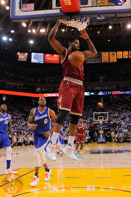 December 25, 2015; Oakland, CA, USA; Cleveland Cavaliers center Tristan Thompson (13) dunks the basketball during the first quarter in a NBA basketball game on Christmas against the Golden State Warriors at Oracle Arena. The Warriors defeated the Cavaliers 89-83.
