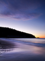 a colorful sky just before sunrise on sand beach in Acadia National Park in Maine