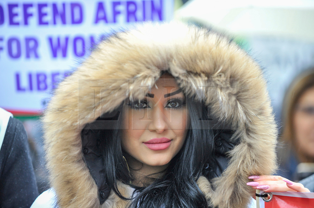 © Licensed to London News Pictures. 27/01/2018. LONDON, UK.  A protester stands outside the BBC as thousands of Kurdish people march from the BBC's Headquarters in Portland Place to Downing Street to protest against Turkey's military invasion of the city of Afrin in Northern Syria, a predominantly Kurdish city.  Protesters called for the British public to show solidarity with the people of Afrin and for the UK to demand that Turkey pull back its forces.  Photo credit: Stephen Chung/LNP
