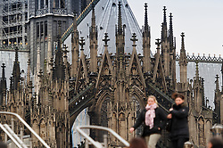 Cologne, Germany, Jan. 2012 -  Pedestrians navigate stairs on Heinrich-Böll-Platz, in front of the Cologne Dom Cathedral in Cologne, Germany. (Photo © Jock Fistick).