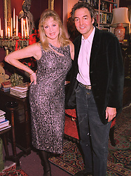 MISS PATTI BOYD former wife of rock star Eric Clapton, and MR ROD WESTON at a party in London on 9th December 1997.MEE 1