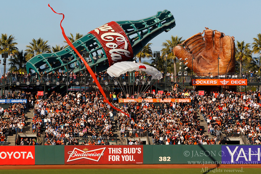 SAN FRANCISCO, CA - APRIL 18:  A skydiver delivers rings during the San Francisco Giants 2014 World Series Ring ceremony before the game against the Arizona Diamondbacks at AT&T Park on April 18, 2015 in San Francisco, California.  (Photo by Jason O. Watson/Getty Images) *** Local Caption ***