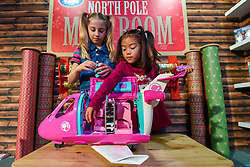 "© Licensed to London News Pictures. 13/11/2019. LONDON, UK. (L to R) Liana (aged 7) and Trilyna (aged 6) play with a Barbie Dreamplane Playset from Mattel at the preview of ""DreamToys"", the official toys and games Christmas Preview, held at St Mary's Church in Marylebone.  Recognised as the countdown to Christmas, the Toy Retailer's Association, an independent panel of leading UK toy retailers, have selected the definitive and most authoritative list of which toys will be the hottest property this Christmas.  Photo credit: Stephen Chung/LNP"