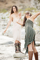 Two Women Two Wild Women dancing in desert wilderness nature.