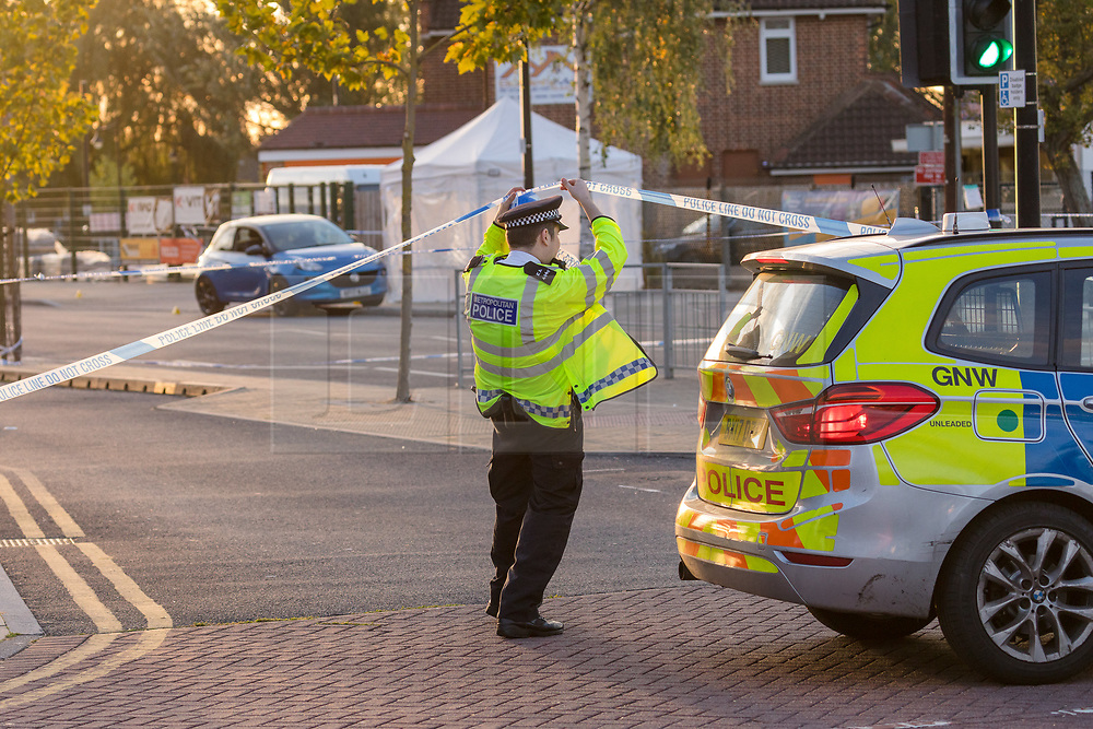 © Licensed to London News Pictures. 13/10/2018. London, UK.  Police at the crime scene at Manford Way in Hainault, where police were called at approximately 10:20pm last night to reports of two men stabbed in Manford Way, Hainault and one man, believed aged 23, was pronounced dead at the scene. The second man, believed aged 22, was taken to an east London hospital for treatment where he remains in a critical condition..  Photo credit: Vickie Flores/LNP