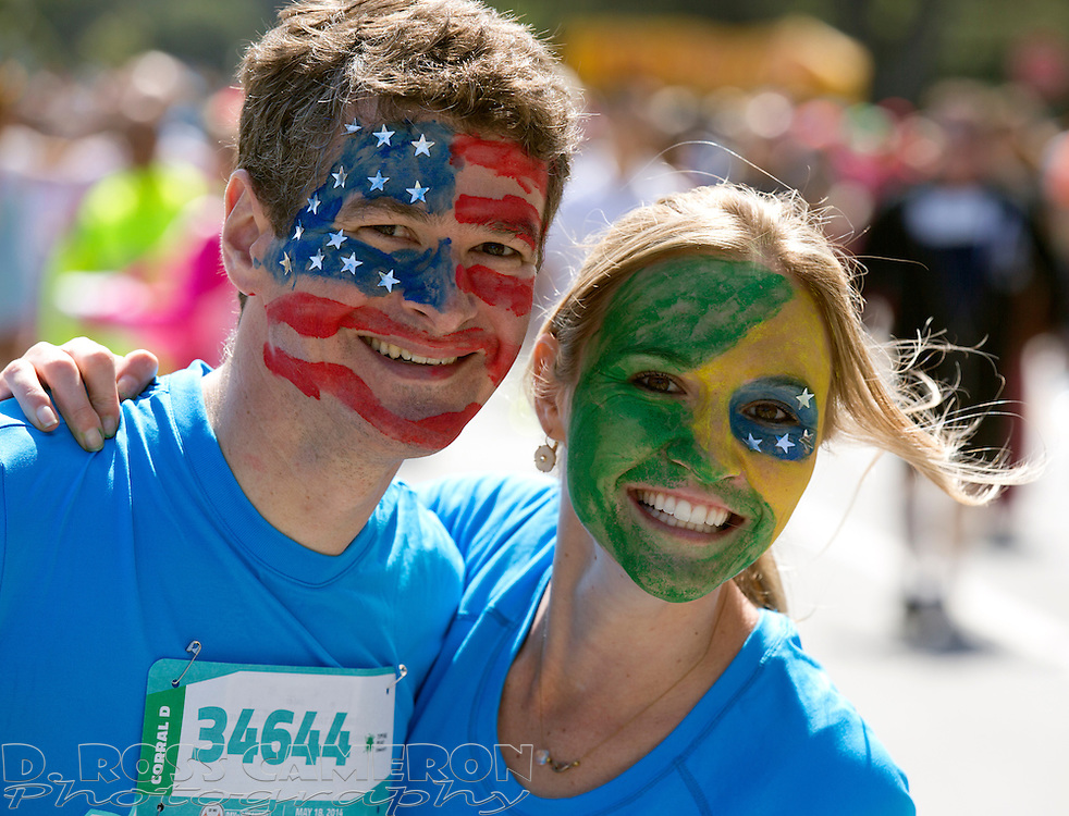 Chris Wilson of Sunnyvale, Calif., left, sports the colors of the American flag on his face, while his friend Janaisa Port of Porto Allegre in Brazil has her's painted with the colors of her home country, during the 103rd running of the Bay to Breakers 12K race, Sunday, May 18, 2014 in San Francisco. (Photo by D. Ross Cameron)