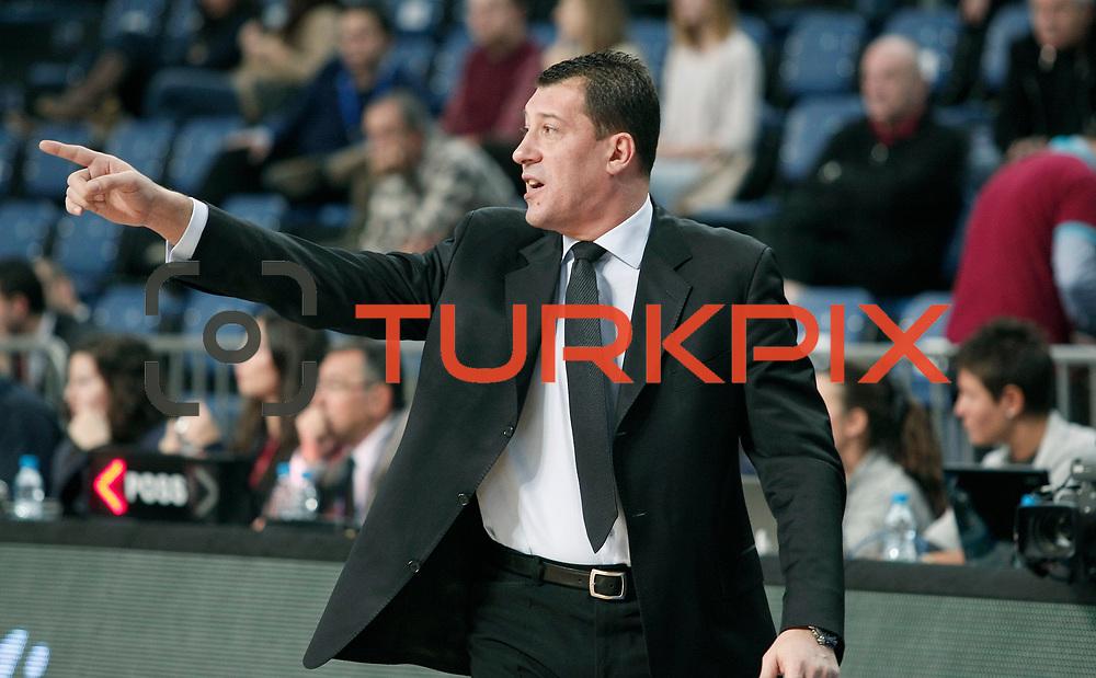 Anadolu Efes's coach Ufuk Sarica during their Turkish Basketball League match Anadolu Efes between Pinar Karsiyaka at Arena in Istanbul, Turkey, Saturday, November 26, 2011. Photo by TURKPIX