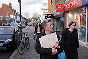 Man out and about on Kings Heath High Street carrying his pizza and coca cola on 13th March 2020 in Birmingham, United Kingdom. Kings Heath is a suburb of Birmingham, three miles south of the city centre. It is the next suburb south from Moseley.