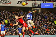 Alfredo Morelos of rangers wins the ball ahead of Andrew Considine of Aberdeen FC during the William Hill Scottish Cup quarter final replay match between Rangers and Aberdeen at Ibrox, Glasgow, Scotland on 12 March 2019.