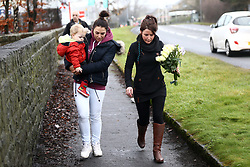 © Licensed to London News Pictures. 22/12/2017. Skipton UK. People lay flowers at  the Aldi store where a 30 year old woman has died after she was stabbed in an Aldi supermarket in Skipton. North Yorkshire Police have arrested a 44 year old man on suspicion of murder following the attack shortly before 3:30 pm on Thursday. Photo credit: Andrew McCaren/LNP