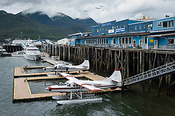 Two de Havilland DHC-3 Otter float planes are docked in the Juneau Harbor next to the Merchant's Wharf Mall in downtown Juneau, Alaska. Float planes are a vital mode of transportation in Alaska where much of the state is only accessable by float plane.