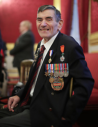 December 12, 2016 - London, United Kingdom - Image licensed to i-Images Picture Agency. 08/12/2016. London, United Kingdom. D-Day veteran Abraham Young, 93, of the Royal Engineers, during a Christmas Party at St James's Palace, London for The Not Forgotten Association - a national tri-service charity which provides entertainment, leisure and recreation for the serving wounded, injured or sick and for ex-service men and women with disabilities. Picture by ROTA / i-Images  UK OUT FOR 28 DAYS (Credit Image: © Rota/i-Images via ZUMA Wire)