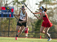 Interlakes/Moultonboro's Reagan Buhrman charges down the field with Belmont's Maddy Lacharite during NHIAA Division III Lacrosse Tuesday afternoon.  (Karen Bobotas/for the Laconia Daily Sun)