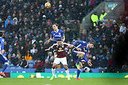 David Luiz of Chelsea jumps above Andre Gray of Burnley. Premier league match, Burnley v Chelsea at Turf Moor in Burnley, Lancs on Sunday 12th February 2017.<br /> pic by Chris Stading, Andrew Orchard Sports Photography.