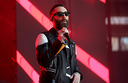 Adam Levine of Maroon 5 on stage during Capital's Summertime Ball. The world's biggest stars perform live for 80,000 Capital listeners at Wembley Stadium at the UK's biggest summer party.