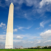 Wide shot of the Washingotn Monument with clouds and blue sky