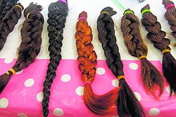 """October 6, 2018 - (07/10/2018) Las personas pueden donar su pelo para pelucas de pacientes con cáncer durante la campaña de octubre en las tiendas Walmart. Hoy estarán en Curridabat, de 9 a. m. a 2 p. m.. PROHIBIDO EL USO O REPRODUCCIÃ""""N EN COSTA RICA. (Credit Image: © Gesline Anrango/La Nacion via ZUMA Press)"""