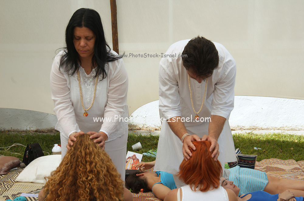 Giving a Deeksha. Deeksah or diksha from Sanskrit meaning initiation an energy transfer, planting the seed of Oneness
