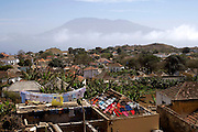 A view of Nova Sintra, the capital village of Brava island situated on a cooler plateau about 600 metres from sea level. On the background massive Fogo island is omnipresent with its 2829 metres vulcano.