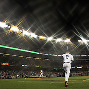 Derek Jeter, New York Yankees, playing in his final season, heads out from the dug out to field at shortstop  during the New York Yankees V New York Mets, Subway Series game at Yankee Stadium, The Bronx, New York. 12th May 2014. Photo Tim Clayton<br /> (Note to editors: A special effects starburst filter used in the creation of this image)