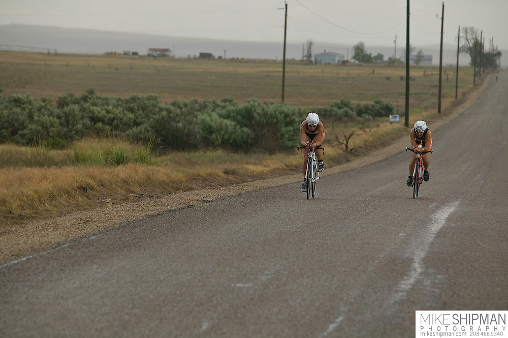 Idaho, Ada County, Boise, Boise 70.3 Ironman, Jennifer Leubke from Missoula, MT, cycles through the desert with Paula Broberg of Tualitin, OR, Luebke finished with a time of 5:05:51