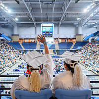 052214       Cable Hoover<br /> <br /> Window Rock High School seniors Kelly Lynch, left, and Candeleresa Brown wave from the balcony of the new Stronghold Event Center before marching with their class to the floor of the arena for the graduation ceremony Thursday in Ft Defiance. The graduating class of 2014 is the first to utilize the new venue.