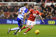 Reading defender Chris Gunter (2) and Nottingham Forest forward Lee Tomlin (15) in action during the EFL Sky Bet Championship match between Nottingham Forest and Reading at the City Ground, Nottingham, England on 20 February 2018. Picture by Jon Hobley.