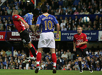 Photo: Lee Earle.<br /> Portsmouth v Manchester United. The FA Barclays Premiership. 15/08/2007.Portsmouth's Benjani (2nL) beats United's Menanja Vidic to head home their first goal.