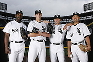 Jose Conteras, Jon Garland, Mark Buehrle and Javier Vazquez pose during a White Sox program cover shoot. (Photo by Ron Vesely).