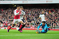 Football - 2016 / 2017 Premier League - Arsenal vs. Tottenham Hotspur<br /> <br /> Hugo Lloris of Tottenham saves from the oncoming Alexis Sanchez of Arsenal at The Emirates.<br /> <br /> COLORSPORT/ANDREW COWIE