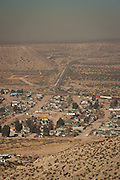 The US - Mexican border as seen from the slums of Anarba, one of the poorest slums of Juarez, where a ready supply of gang members fuel the ongoing drug war in  Mexico January 15, 2009. The drug war has already claimed more than 40 people since the start of the year. More than 1600 people were killed in Juarez in 2008, making Juarez the most violent city in Mexico.    (Photo by Richard Ellis)