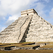 Wide shot of the Temple of Kukulkan (El Castillo) at Chichen Itza Archeological Zone, ruins of a major Maya civilization city in the heart of Mexico's Yucatan Peninsula.