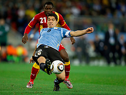 Kwadwo Asamoah of Ghana vs Luis Suarez of Uruguay  during to the 2010 FIFA World Cup South Africa Quarter Finals football match between Uruguay and Ghana on July 02, 2010 at Soccer City Stadium in Sowetto, suburb of Johannesburg. (Photo by Vid Ponikvar / Sportida)