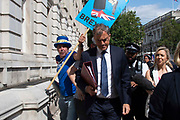 Julian Smith MP, Secretary of State for Northern Ireland  leaves the Cabinet office in Whitehall, London, United Kingdom on 20th August 2019.