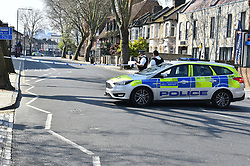 © Licensed to London News Pictures. 27/03/2020.  London UK: Police close off  Barking road, Plaistow, east London after the body of a female in her early forties was found on Thursday afternoon. Detectives have launched a murder investigation after the woman was pronounced dead at the scene  , Photo credit: Steve Poston/LNP