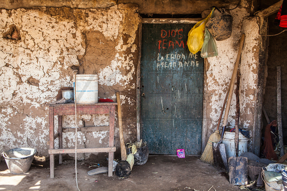 2014/11/22 – Quimili, Argentina: The entry of one of the houses in the allotment number 5 of the Guaycurú Indigenous Community. Many of the Guaycurú population still live in a traditional way with houses made of cob, a mixture of compressed clay and straw and surrounded by animals. (Eduardo Leal)