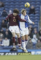 Photo: Aidan Ellis.<br /> Blackburn Rovers v Arsenal. The Barclays Premiership. 25/02/2006.<br /> Blackburn's Morten Gamst Pedersen and Arsenal's Cesc Fabregas
