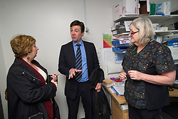 © Licensed to London News Pictures. 14/05/2012. London, UK. Shadow Health Secretary Andy Burnham MP (centre) and Karen Buck, MP for Westminster North (left) speaking to Practice Nurse Glynis Law (right).during a visit to Half Penny Steps Health Centre in North West London on May 14, 2012. Photo credit : Ben Cawthra/LNP