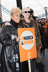 © Licensed to London News Pictures. 05/03/2017. LONDON, UK.  Emeli Sandé with Annie Lennox and feminist activists take part in the March4Women, organised by CARE International to mark International Women's Day. The Women's Day March begins at The Scoop near City Hall, before proceeding over Tower Bridge and finishing at the Tower of London. Photo credit: Vickie Flores/LNP