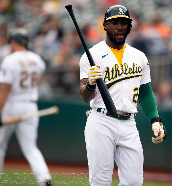 Sep 26, 2021; Oakland, California, USA; Oakland Athletics center fielder Starling Marte (2) walks back to the dugout after striking out against Houston Astros starting pitcher Jake Odorizzi in the first inning at RingCentral Coliseum. Mandatory Credit: D. Ross Cameron-USA TODAY Sports