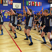 England players, (not in picture) Jonny Wilkinson, Dan Cole, Tom Croft and Steve Thompson, are greeted with the Haka on a visit to Wakatipu High School, Queenstown where the players coached the schools rugby team. The England team are in Queenstown during the IRB Rugby World Cup tournament.  Queenstown, New Zealand.15th September 2011. Photo Tim Clayton..