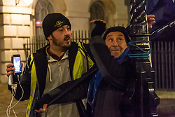 Pro-Brexit campaigner James Goddard, left, attempts to remove an EU flag strapped to a lamppost as a SODEM campaigner, right, tries to foil him as Goddard once again tries to disrupt Steve Bray's SODEM anti-Brexit protest the day after he was seen harassing former cabinet minister Anna Soubry. Westminster, London, December 20 2018.