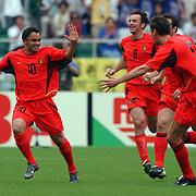 Belgium's Johan Walem celebrates scoring their opening goal